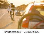 cyclist man riding mountain... | Shutterstock . vector #235305523