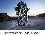 cyclist man riding mountain...   Shutterstock . vector #235305568