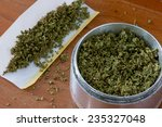 grinder and papers for rolling... | Shutterstock . vector #235327048