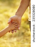 a parent holds the hand of a... | Shutterstock . vector #235328080