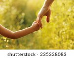 a parent holds the hand of a... | Shutterstock . vector #235328083