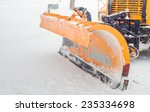 Snow Plow Doing Snow Removal...
