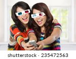 teenager watching a 3d movie...   Shutterstock . vector #235472563