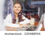 woman behind the glass of a cafe