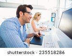 graphic designer using a... | Shutterstock . vector #235518286
