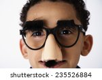 Small photo of Boy in Groucho Glasses