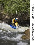 Whitewater Kayaker Navigating...