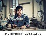 young craftsman in uniform... | Shutterstock . vector #235561573