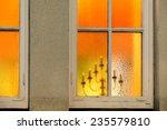 candlestick seen through window ...   Shutterstock . vector #235579810
