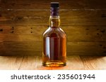 bottle  of whiskey  on a wooden ... | Shutterstock . vector #235601944