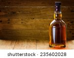 bottle  of whiskey  on a wooden ... | Shutterstock . vector #235602028