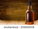 bottle  of whiskey  on a wooden ... | Shutterstock . vector #235602028