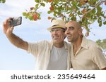 vacation  gay couple taking a... | Shutterstock . vector #235649464