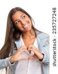 beautiful woman making a heart... | Shutterstock . vector #235727248