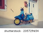 old blue scooter parked by the... | Shutterstock . vector #235729654