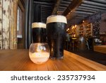 dark beer and candle in pub... | Shutterstock . vector #235737934