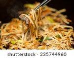 preparing pad thai at a street...   Shutterstock . vector #235744960
