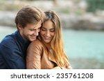 Couple Cuddling Affectionate O...