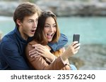 Shocked Couple Watching A Smar...