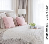 pink pillows on bed with white... | Shutterstock . vector #235764334