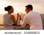 romantic young couple toasting... | Shutterstock . vector #235800823