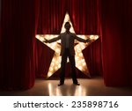 man on stage with star on... | Shutterstock . vector #235898716