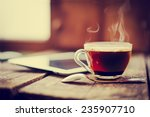 digital tablet  and cup of... | Shutterstock . vector #235907710