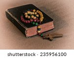 wooden rosary and prayer book.... | Shutterstock . vector #235956100