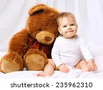 smiling baby playing with teddy ... | Shutterstock . vector #235962310