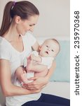 newborn baby with his young... | Shutterstock . vector #235970368