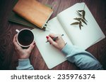 woman hands drawing or writing  ... | Shutterstock . vector #235976374