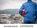 engineer in safety suit stand... | Shutterstock . vector #235990390