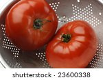 tomatoes in a colander | Shutterstock . vector #23600338