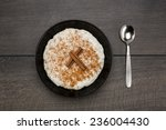 one serving of rice pudding on... | Shutterstock . vector #236004430