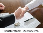 estate agent shaking hands with ... | Shutterstock . vector #236029696