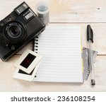 old camera and film with diary... | Shutterstock . vector #236108254
