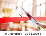 Grand opening  cutting red...