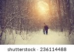 Couple On Winter Path In Fores...