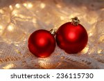 Two Red Christmas Balls On A...