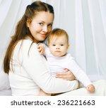 portrait happy mother and baby... | Shutterstock . vector #236221663