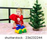 baby boy playing with santa... | Shutterstock . vector #236232244