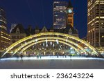 Stock photo christmas decorations at nathan phillips square in toronto and people skating in a free city 236243224