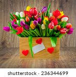 tulips in the box on wooden... | Shutterstock . vector #236344699