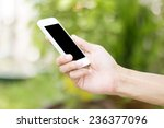 hand holding smart phone with... | Shutterstock . vector #236377096