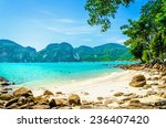 Exotic beach with blue sky, blue water and white sand in the background, South Asia