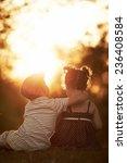 lovely boy and girl on sunset | Shutterstock . vector #236408584