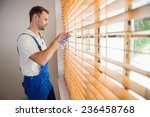 handyman cleaning blinds with a ... | Shutterstock . vector #236458768