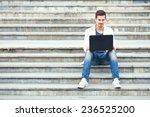 young man sitting on the stairs ... | Shutterstock . vector #236525200