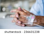 patient with iv drip in a... | Shutterstock . vector #236631238
