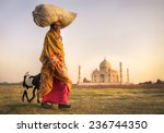 Indian Woman Carrying On Head...